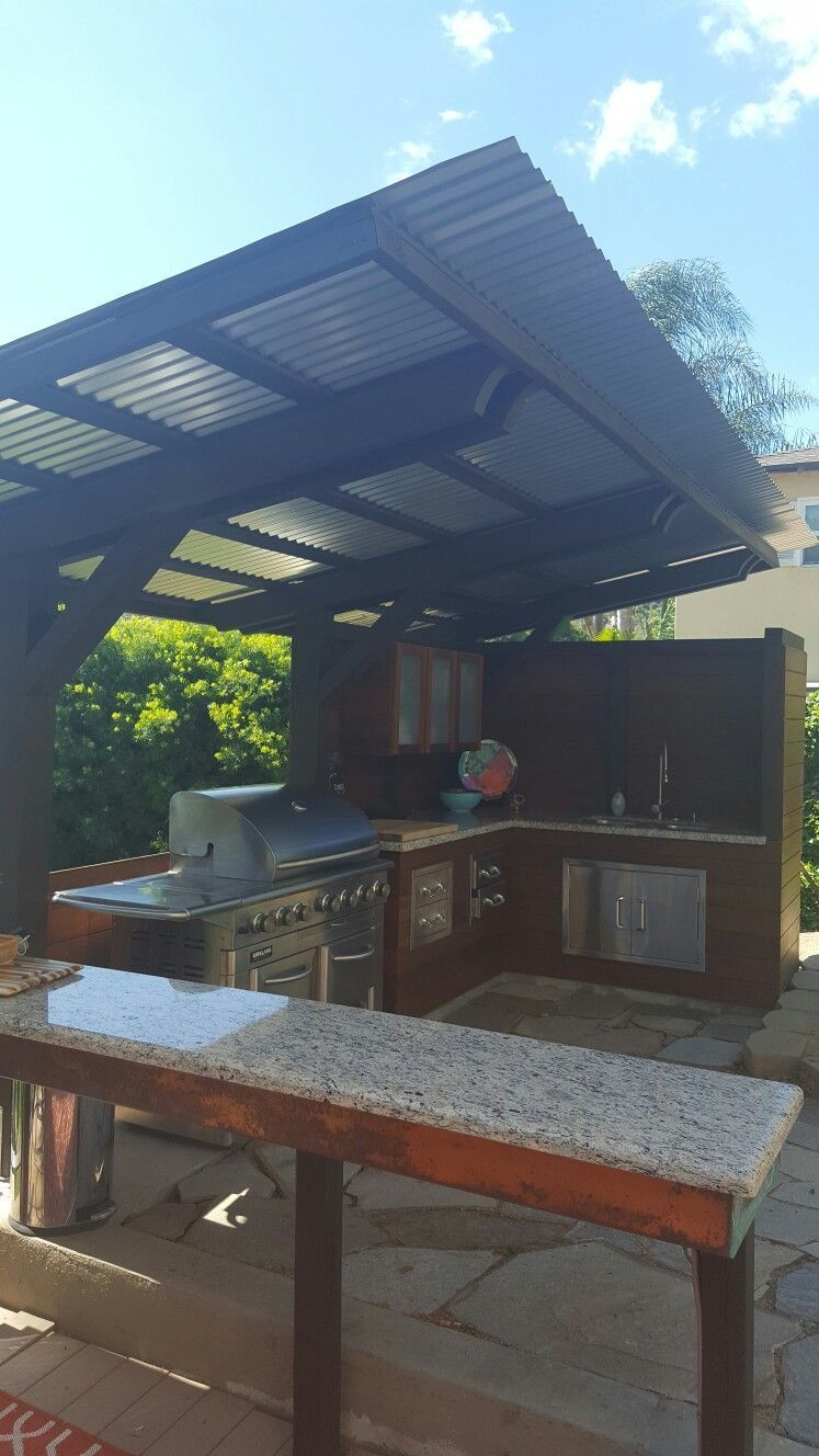 Cantilever corrugated sheet metal roof outdoor kitchen
