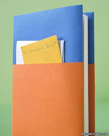 Two pieces of construction paper make a pocket around a book.  I wonder if 2nd graders could keep this neat...
