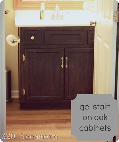 We used gel stain no sanding on our oak cabinet in our for Can you use kitchen cabinets in bathrooms