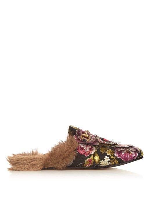 Gucci's backless Princetown loafers are crafted in Italy from an opulent black, pink, and green floral brocade.