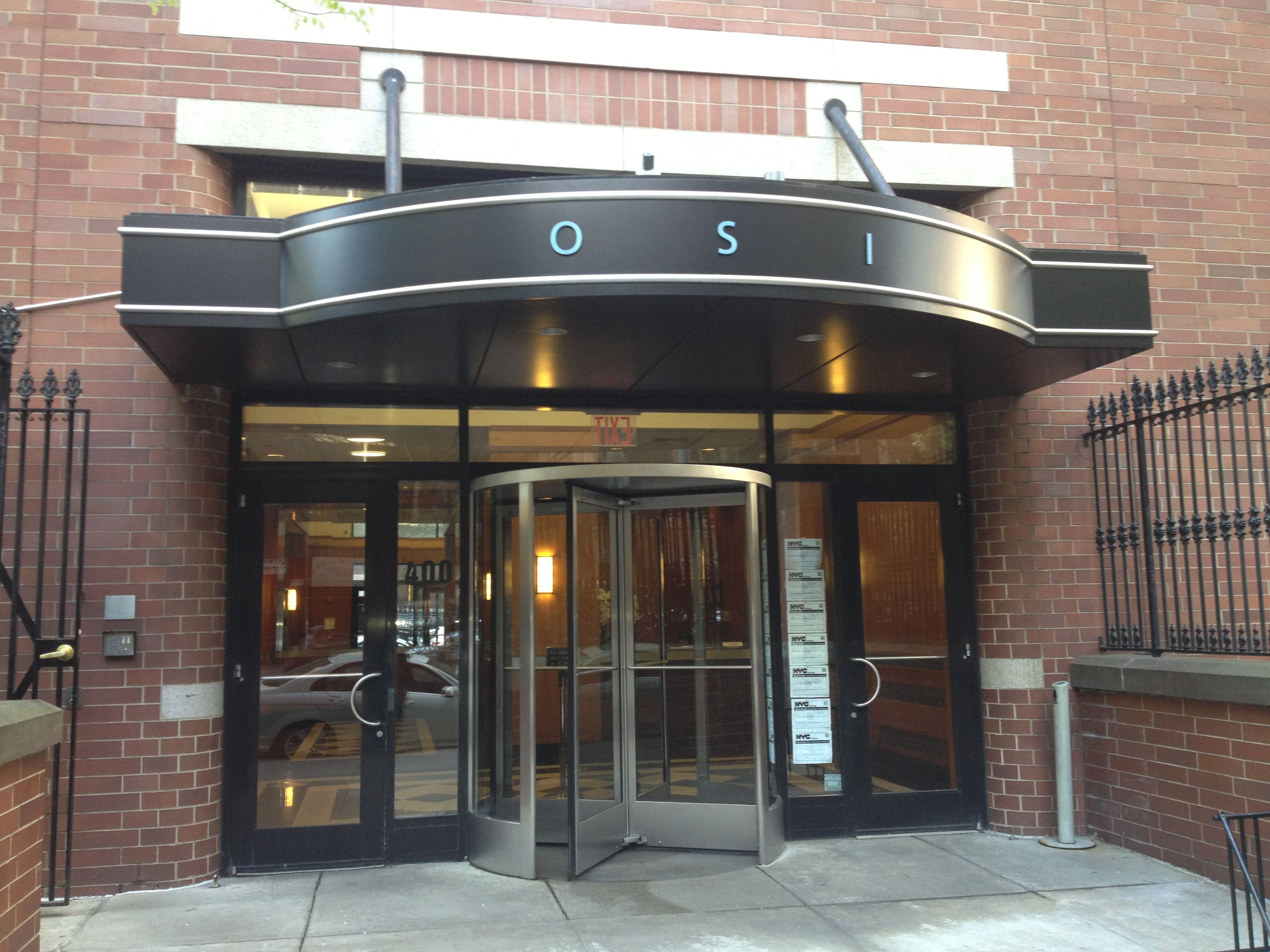 Curved Canopy of Black anodized Aluminum  Revolver and Doors for NYC Commercial Building Columbus Place & Curved Canopy of Black anodized Aluminum  Revolver and Doors for ... Pezcame.Com