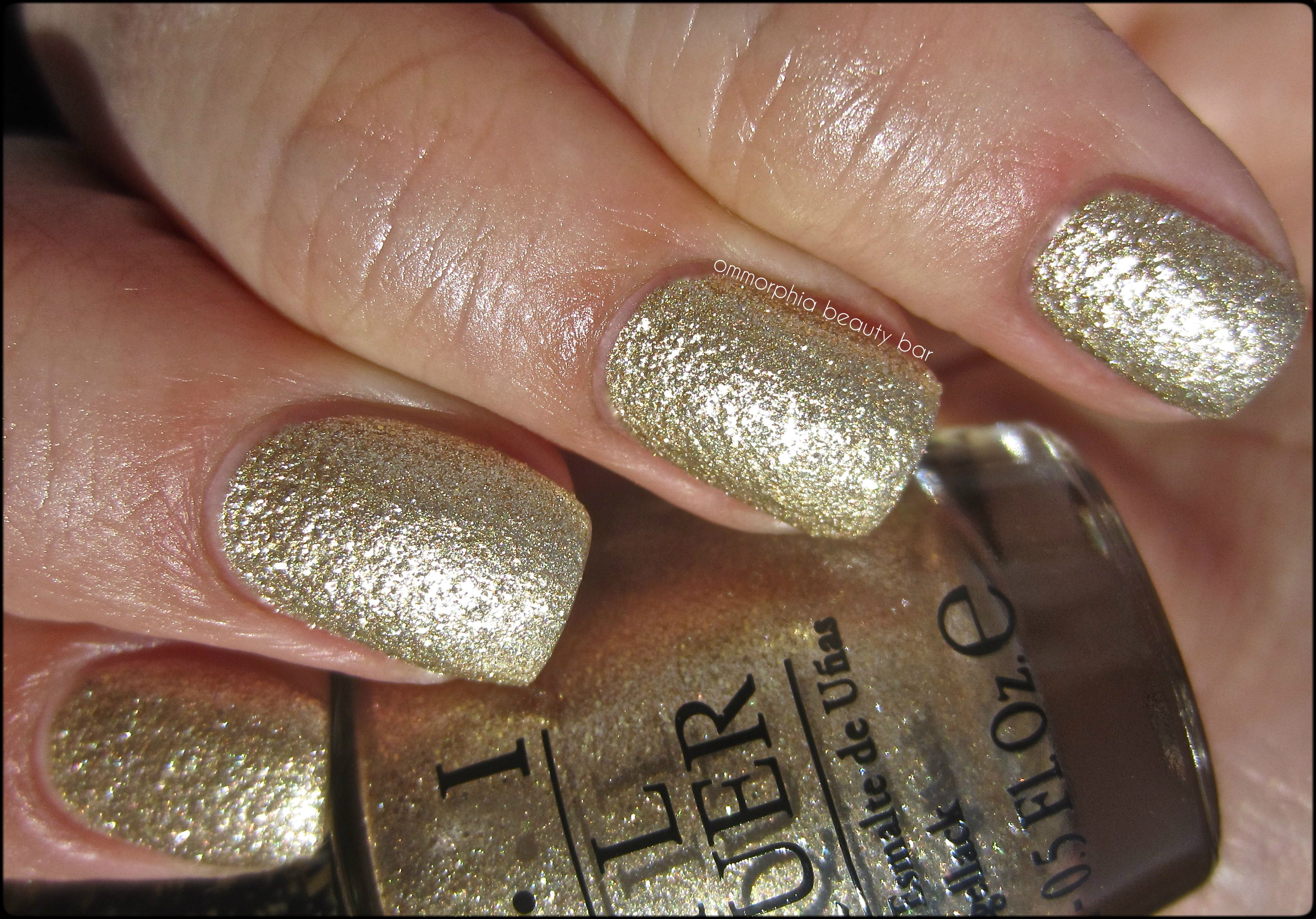 Gold Finger A glittery gold w/ gritty texture transforms your nails ...