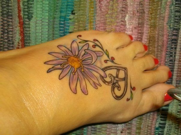 My Foot Tattoo Aster September My Anniversary Month And Heart W Cross Pendant Tattoos Foot Tattoo Inspirational Tattoos