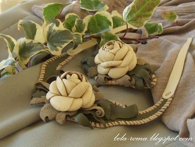Leather flowers with tutorial & pattern.  In Russian but I used Google translate and could understand the directions.