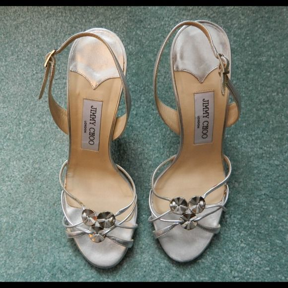 Jimmy Choo Strappy Leather Slingback Heels HOLIDAY BLOWOUT PRICING!! 500.00 OFF!!Gorgeous and in mint condition. One tiny flaw on the upper heel (left I believe). This could easily be fixed with a dab of clear glue or nail polish or take to the cobbler. This are beautiful & classy!!! Marked size 8.5. Dustbag includedPRICE FURM UNLESS BUNDLED!! Jimmy Choo Shoes Heels