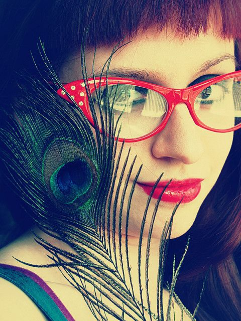40e300685f1b1 Red cat-eye glasses and peacock feather.  WildAtHeart  RedDoorSpa   MyRedDoor  ElizabethArden  TheRedDoorGal
