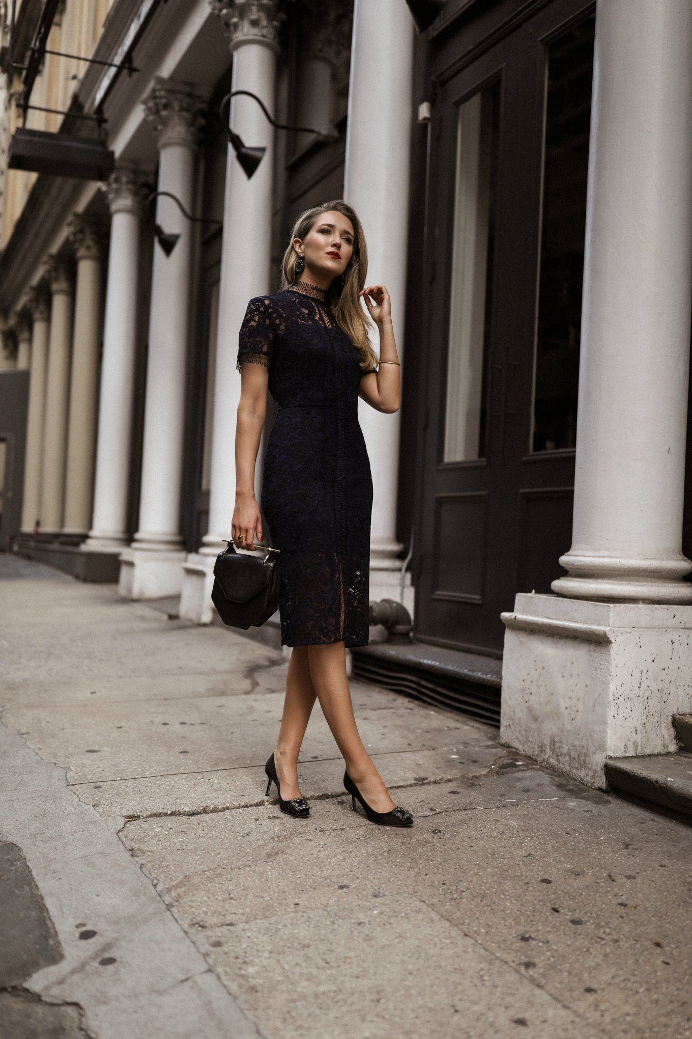 0238a144946 NYC style blogger Mary Orton in Lover Cecilia navy lace dress with  M2Malletier Amor Fati Single Leather Shoulder bag and Manolo Blahnik  Hangisi Pointed Pump