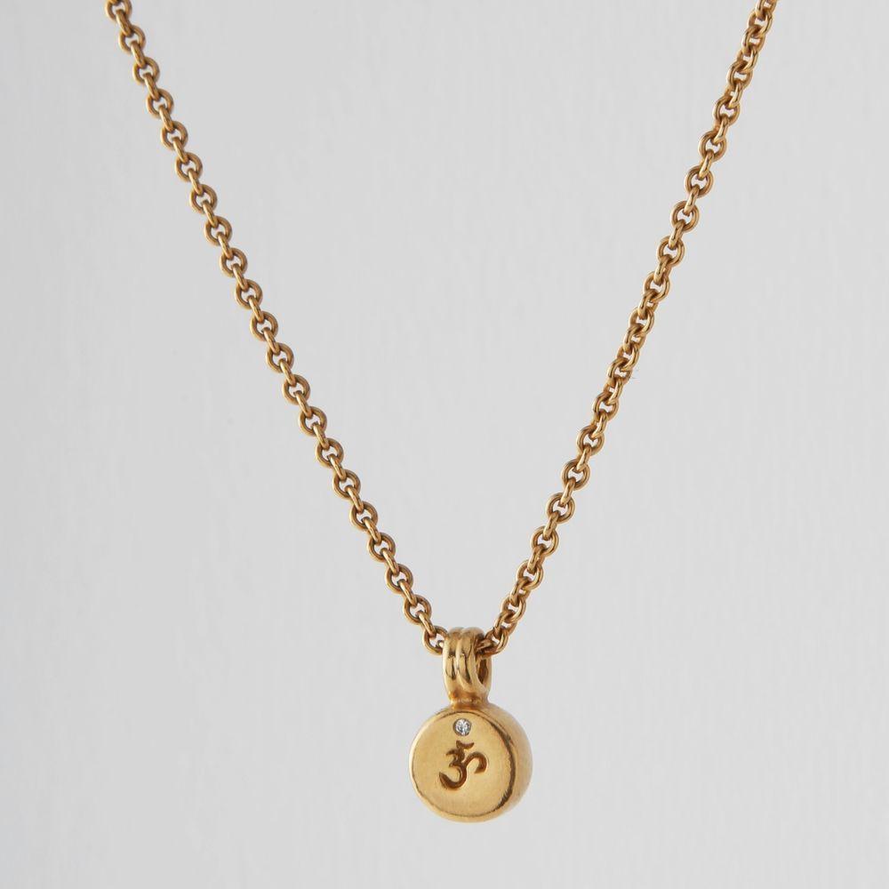 Me u ro k gold om drum pendant with diamond drum pendant k