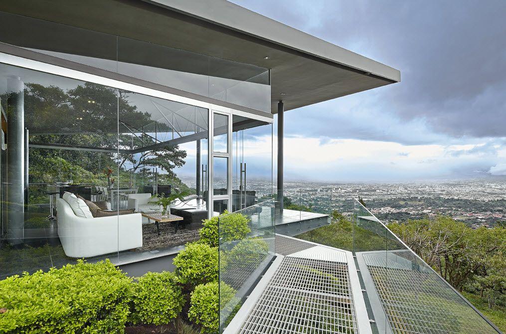 Diseño de pequeña casa de cristal y acero que se integra al entorno ...