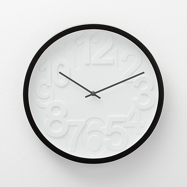 This Contemporary Wall Clock Has Graphic Raised Numbers That Mark Time With Stylish Tone On Tone Shadowing Simply Framed In Black With M Clock White Wall Clocks Crate Barrel