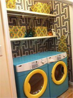 This is making the most out of a small space. I wouldn't even shut these closet doors if this were my laundry. How cute is this?! It almost makes me want to be domestic. Most of us don't have such cute washers and dryer though, but a cute patterned curtain across the front could do the trick.