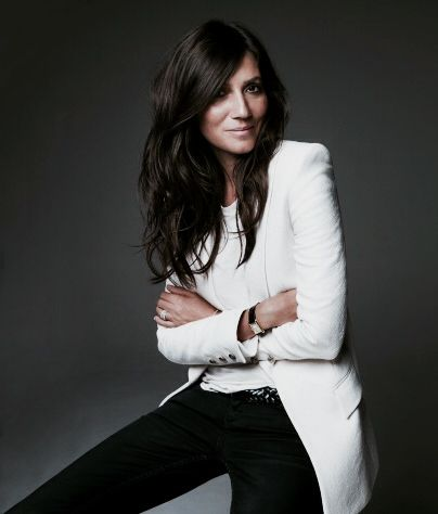 """Emmanuelle Alt is the editor in chief of the inimitable Vogue Paris. She scored her first big break with an assisting job at French Elle in the early 90's. She most frequently collaborates with photographer David Sims, with whom she has had a close working relationship for years. """"Her style is her big shoulders, long legs, tight jeans, sleeves up to the elbow, one hip out. I personally like her. She's a handsome French woman,"""" proclaims Karl Lagerfeld."""