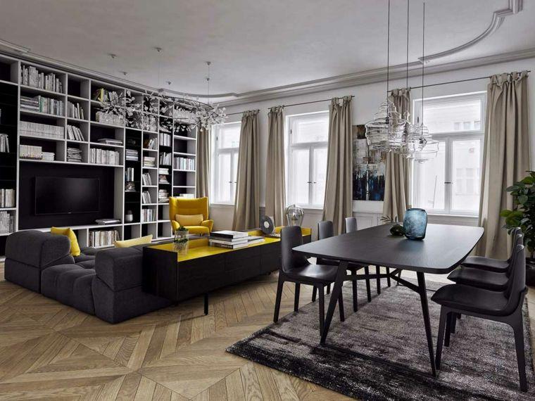 Esempi arredamento soggiorno con un divano nero imbottito e mobili ...