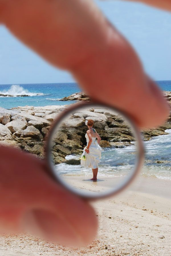 Take a photo THROUGH your spouses wedding ring it would be cute