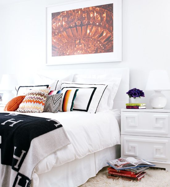 white bedding, Hermes throw, Missoni pillows, fur rug