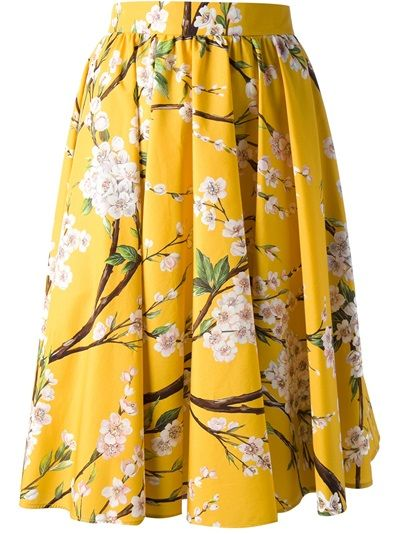 81a9fa71a Yellow cotton pleated floral skirt from Dolce & Gabbana featuring an a-line  shape, a rear zip fastening, a multi coloured floral print and a ...