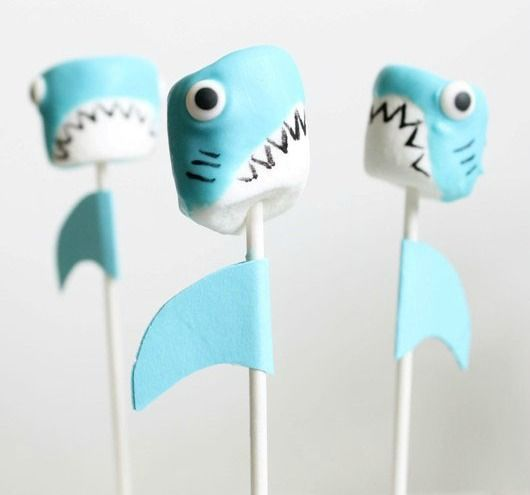 Shark marshmallows on stick! Such a fun treat for an ocean themed party.