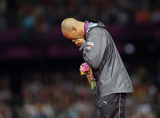 Felix Sanchez of the Dominican Republic breaks down in tears during his gold medal ceremony after winning the men's 400m hurdles final. He won the gold medal with exactly the same time – 47.63 secs – he ran at Athens eight years ago, but had failed to make the final in BeijingPhotograph: Robert Ghement/EPA