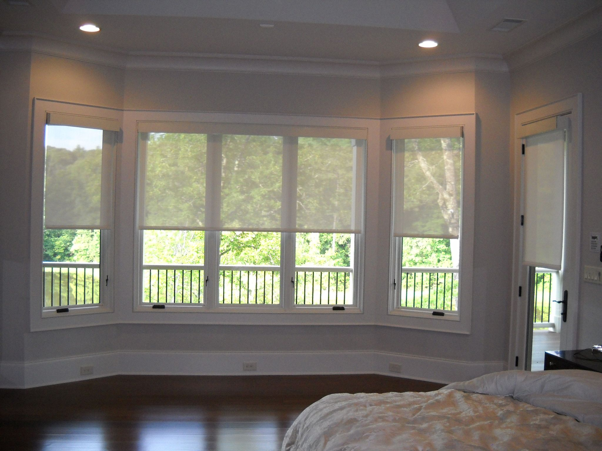 motorized solar shades halfway down bay window
