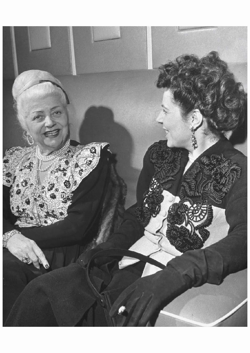 Couturiere Nina Ricci (L) sitting with woman aboard Queen Elizabeth 1946 Ed  Clark. Find this Pin and more ...