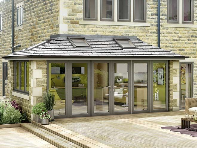 Modern grey conservatory attached to a stone house with for Kitchen with sunroom attached