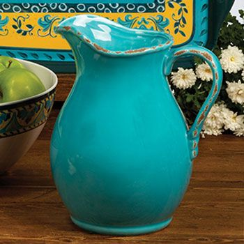 Lovely in all it's simplicity (plus I love the yellow in the background)  Mexican Turquoise Ceramic Pitcher