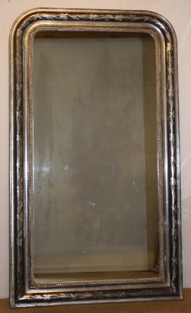 Narrow French antique archtop mirror with etched silver leaf frame on dark grey background, beaded sight edge and original glass in good condition.