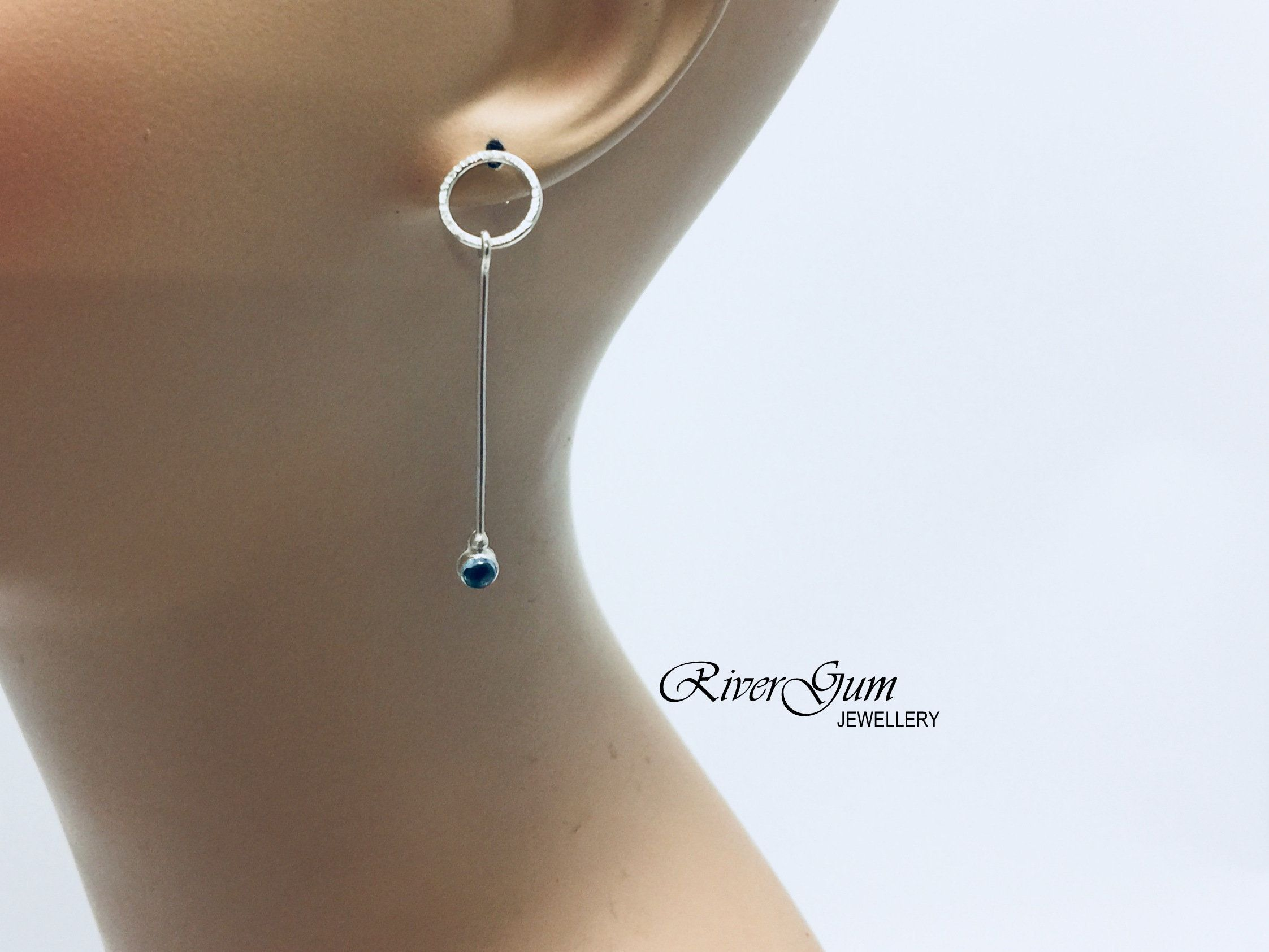 finish swiss birthday long december topaz blue circle silver drops earrings pin hammered stud