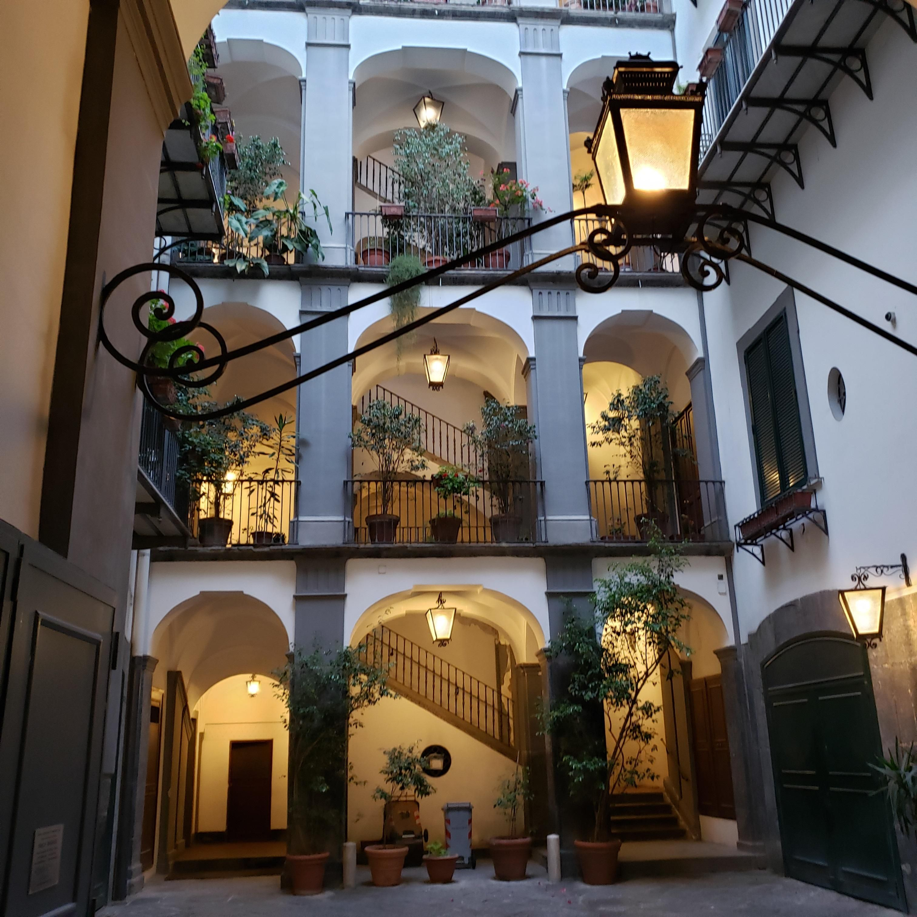 This cozy courtyard in the spanish quarter in Naples Italy Check out desigedecors.com to get more inspiration #interiordesign #cozyplace #rustic #homedecoration