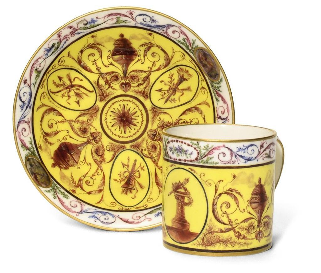 A SEVRES YELLOW-GROUND COFFEE CUP & SAUCER, 1787.