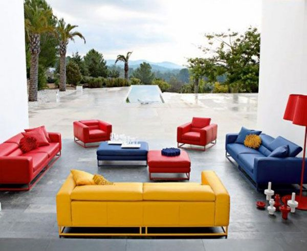 The Red Couch And Chairs Blue Couch And Yellow Couch Give This Space A Triadic Color Sche Colorful Sofa Living Room Colourful Living Room Living Room Designs