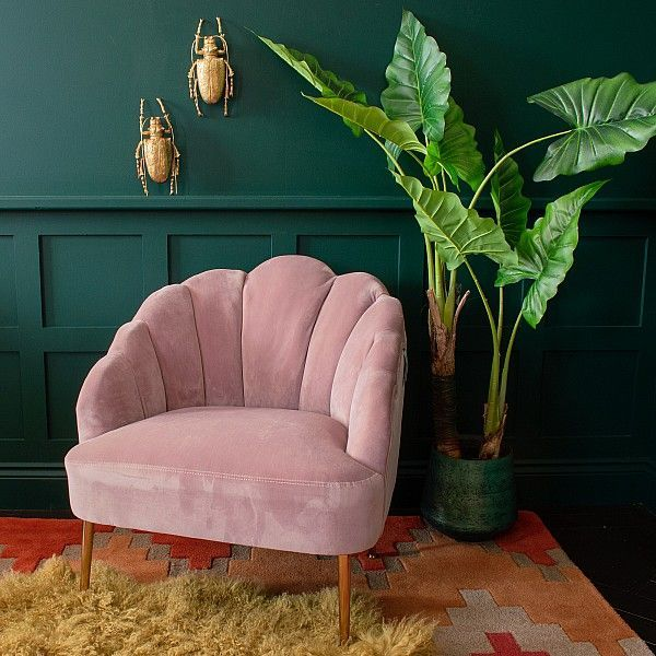 Bring a touch of Art Deco elegance to your interior space with the Scalloped Oyster Velvet Chair. In a soft lilac/pink velvet for a blushingly feminine occasional chair that shouts glamour.