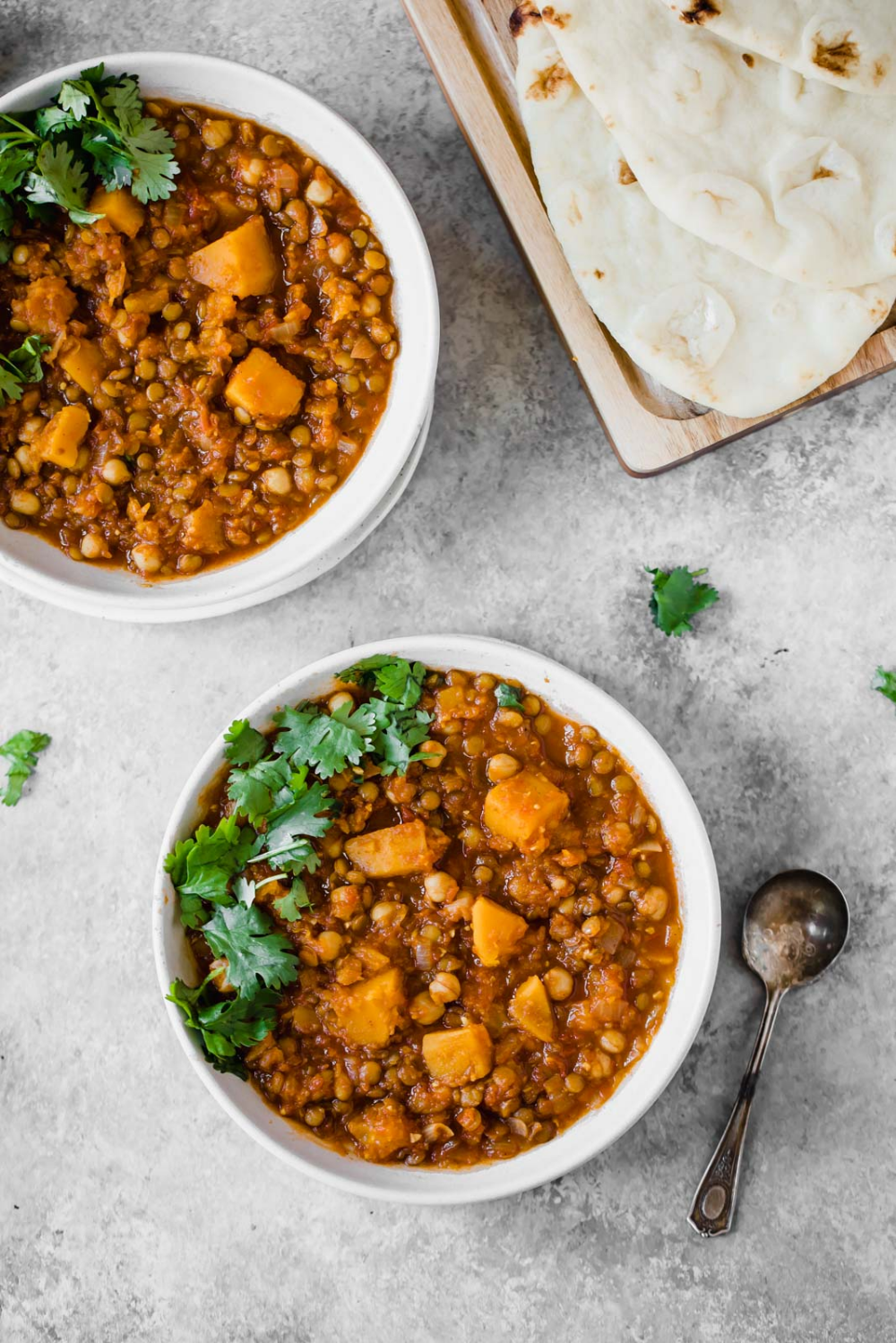 A healthy Moroccan stew with cozy spices, butternut squash, chickpeas, and lentils! You'll love this protein and fiber packed meal! #moroccanfood #comfortfood #healthyfood #healthydinner #vegetarianfood #vegetarianrecipe