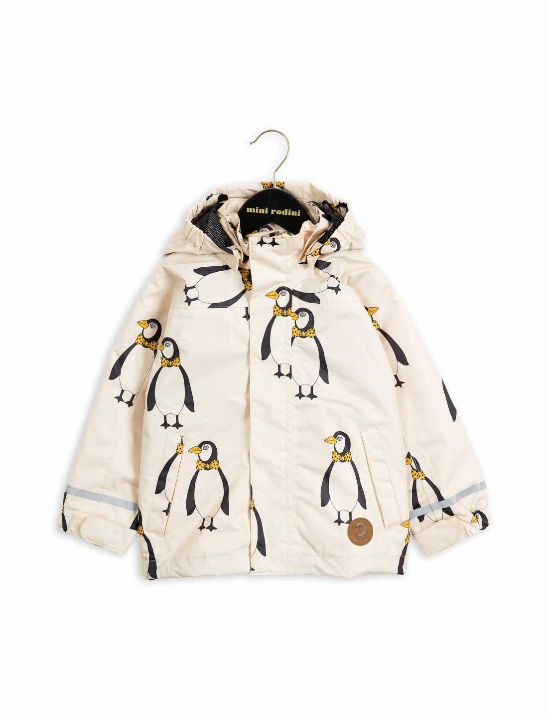 Highly functional and very durable beige shell jacket with printed penguins and environmentally friendly BIONIC-FINISH® ECO coating.