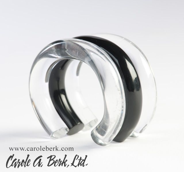 Judith Hendler, ACRI-GEMS  black and clear 3 part tubular lucite cuff. It measures 1 1/2 inches wide with a 1 1/8 inches opening. This will fit a small to normal size wrist. This bracelet is made from old new stock$325.