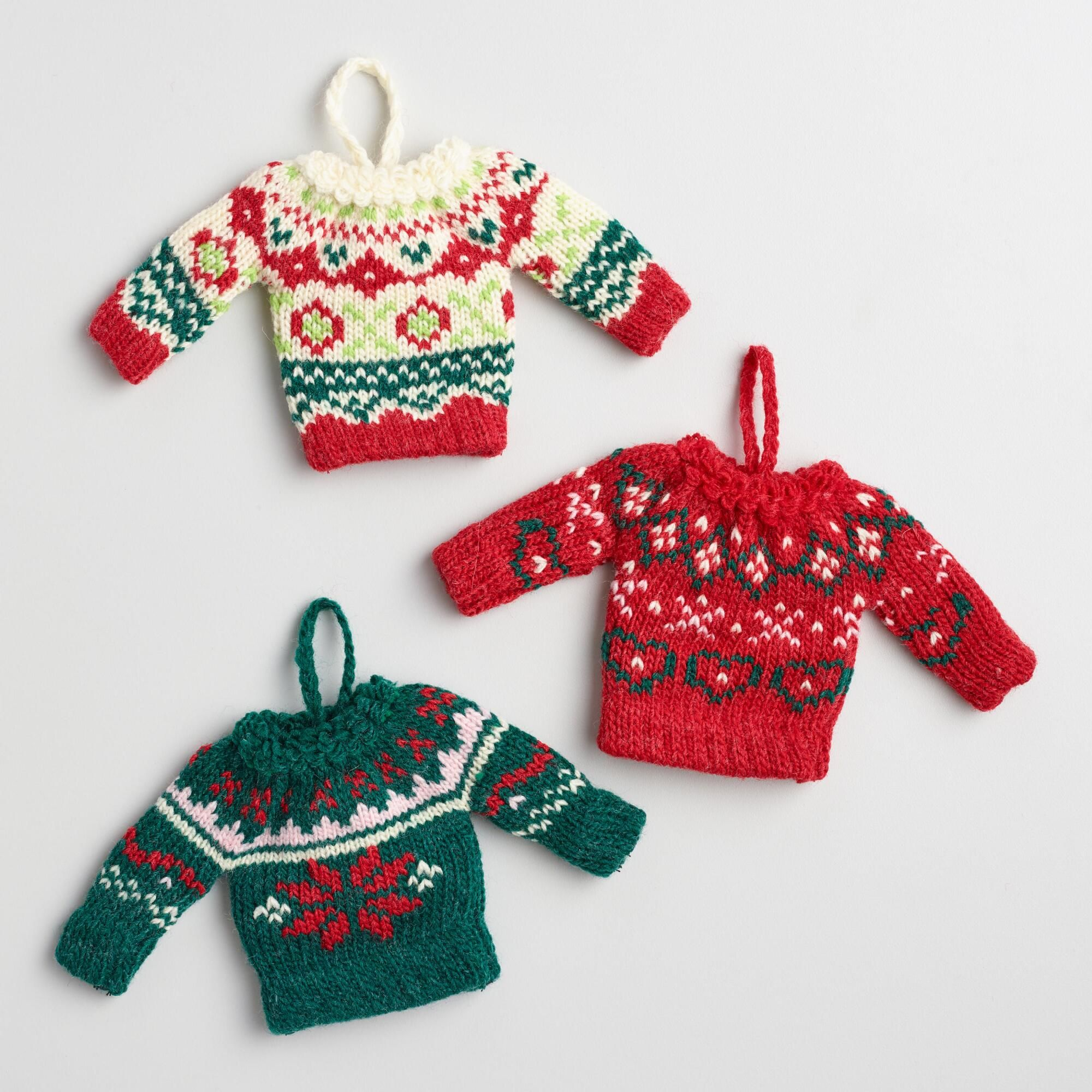Handcrafted of yarn, these mini holiday sweater ornaments