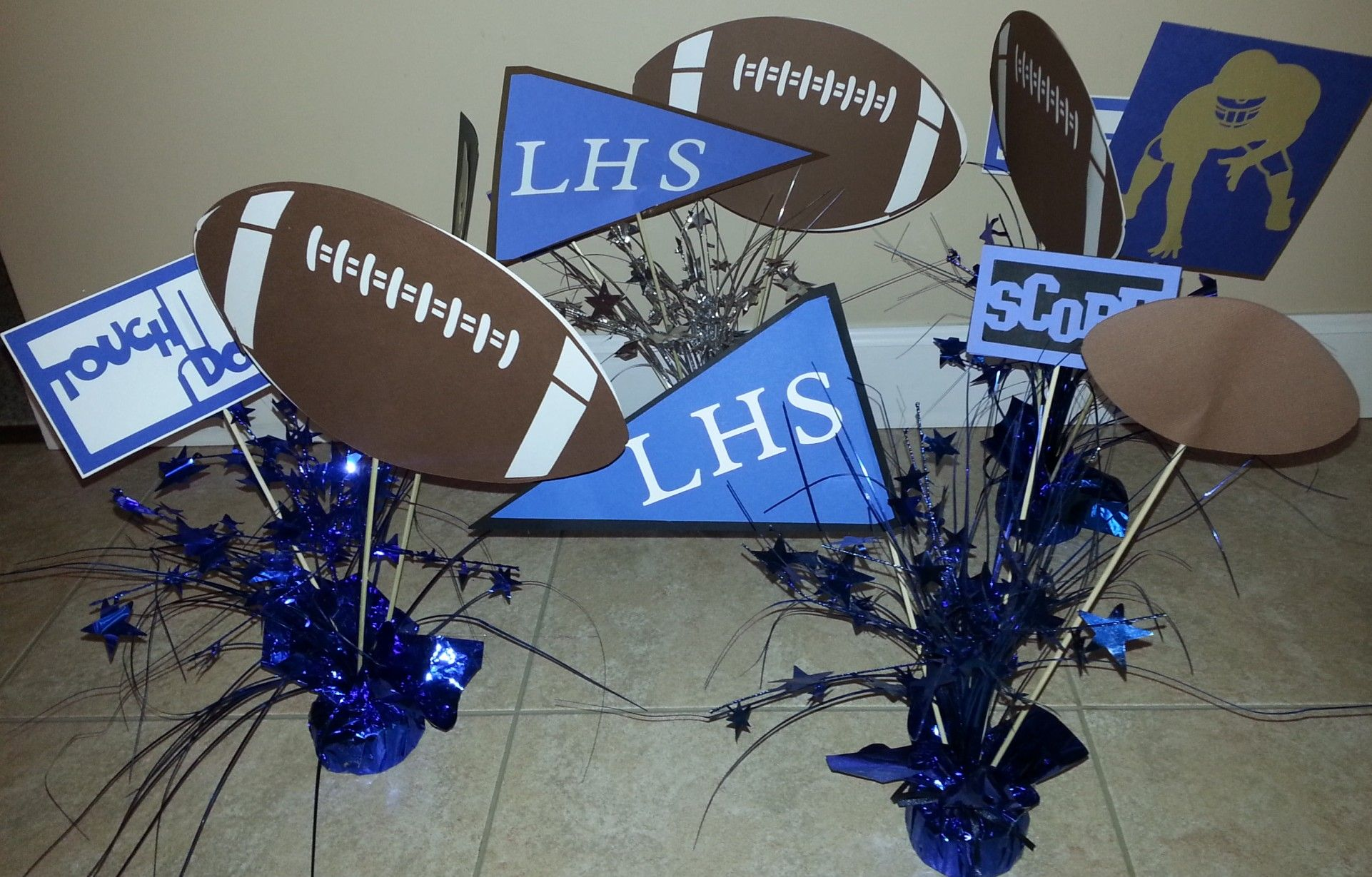 Inexpensive idea for sports banquet centerpieces. Bought