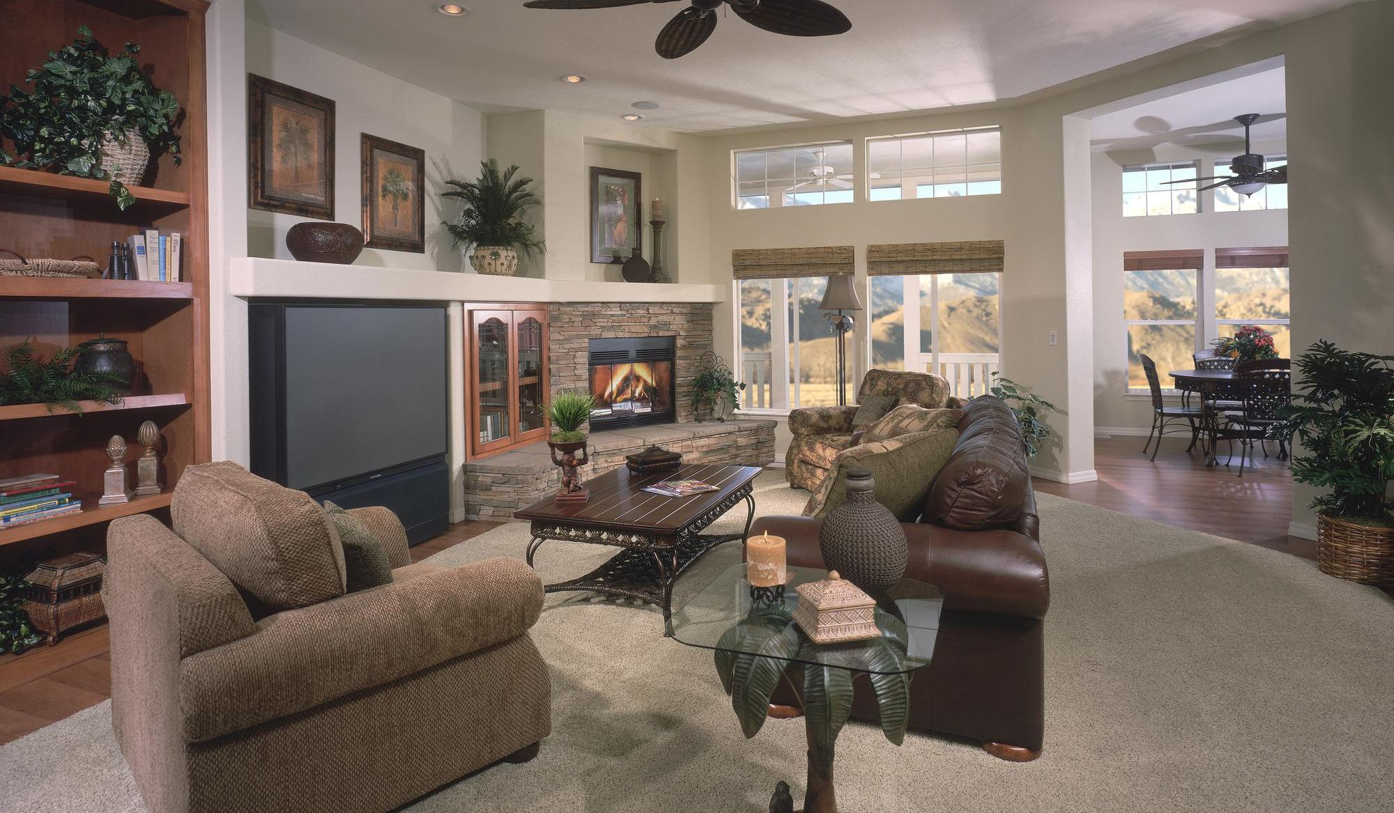 corner fp Stone wall living room, Living room with