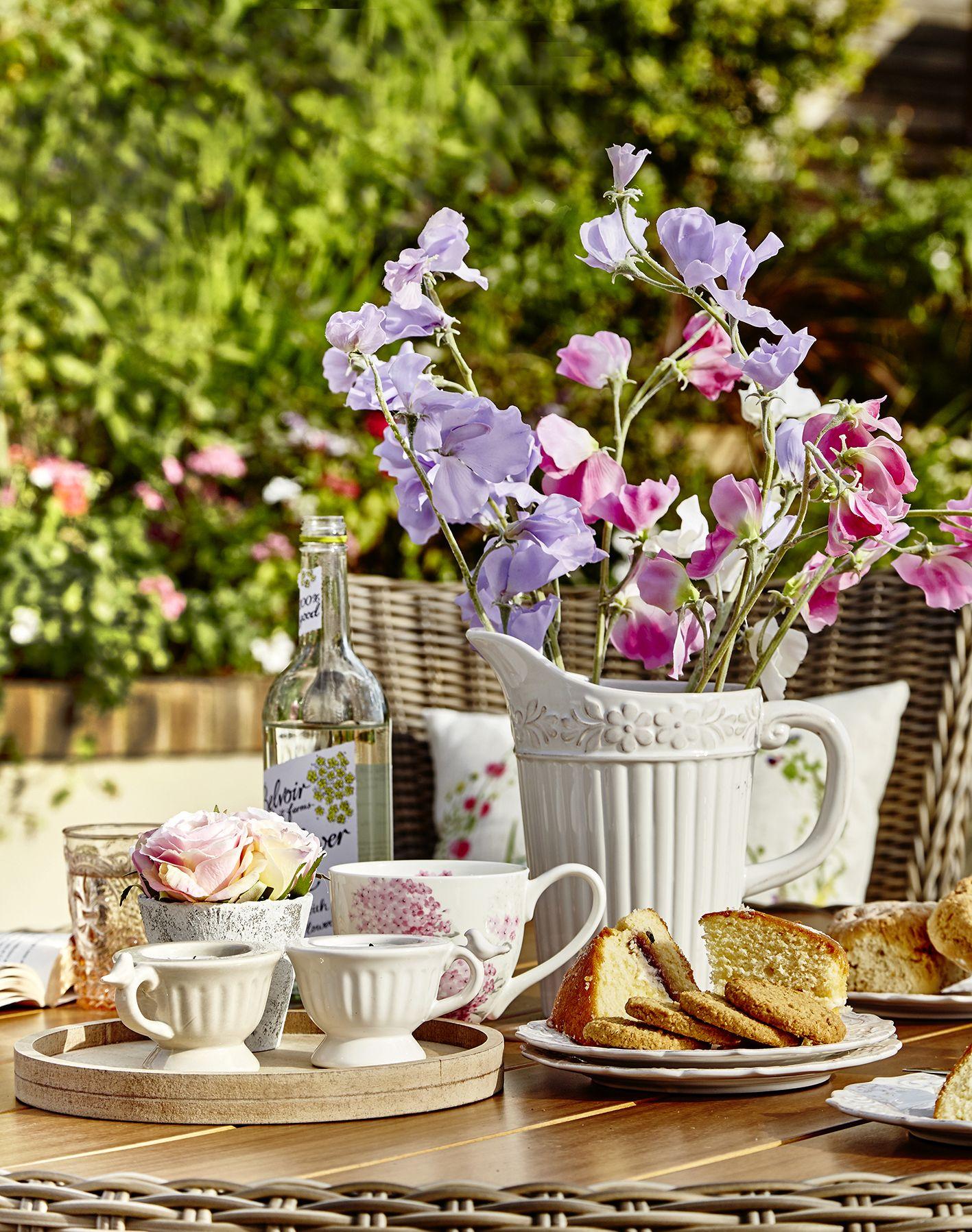 Ribbed white flower jug £16.99; Floral mugs £5.99; Teacup with bird tealight holder £3.99. www.dobies.co.uk