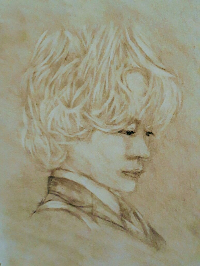Boy Drawing with eraser.