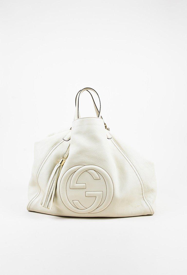 91022065369 Gucci Cream Pebbled Leather Fringe Tassel