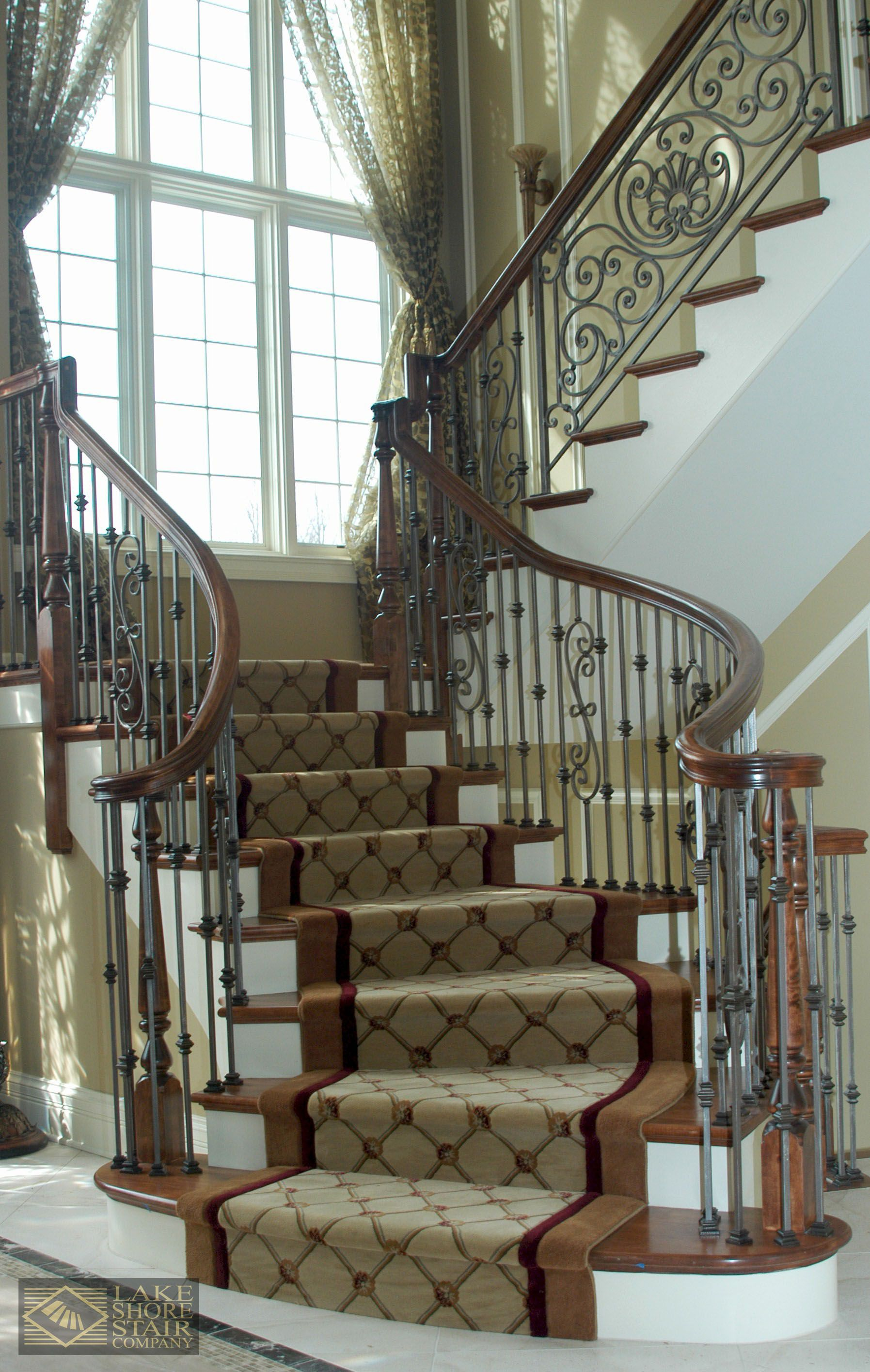 Traditional L Shaped #staircase With A Curving Finish. Patterned Carpet  Runner And Wrought Iron Balusters. #stairs #interiordesign