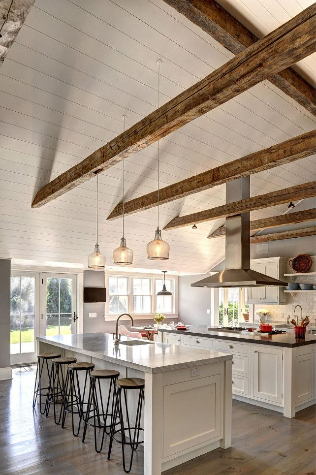 Ranch cottage with transitional coastal interiors the for Half vaulted ceiling with beams