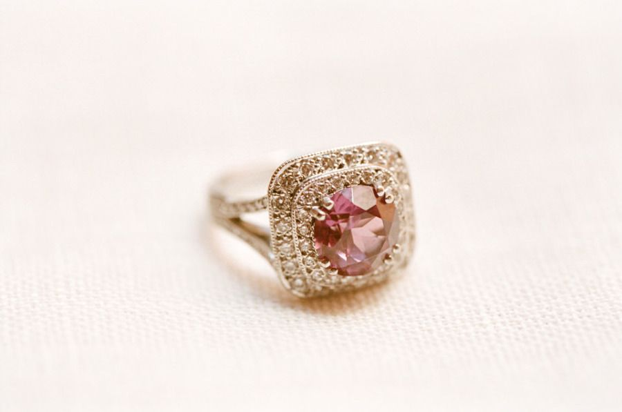 Round cut pink sapphire & square double diamond halo: http://www.stylemepretty.com/2015/05/16/23-vintage-inspired-engagement-rings/