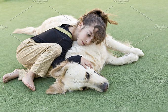 Little girl with her dog . People Photos. $12.00