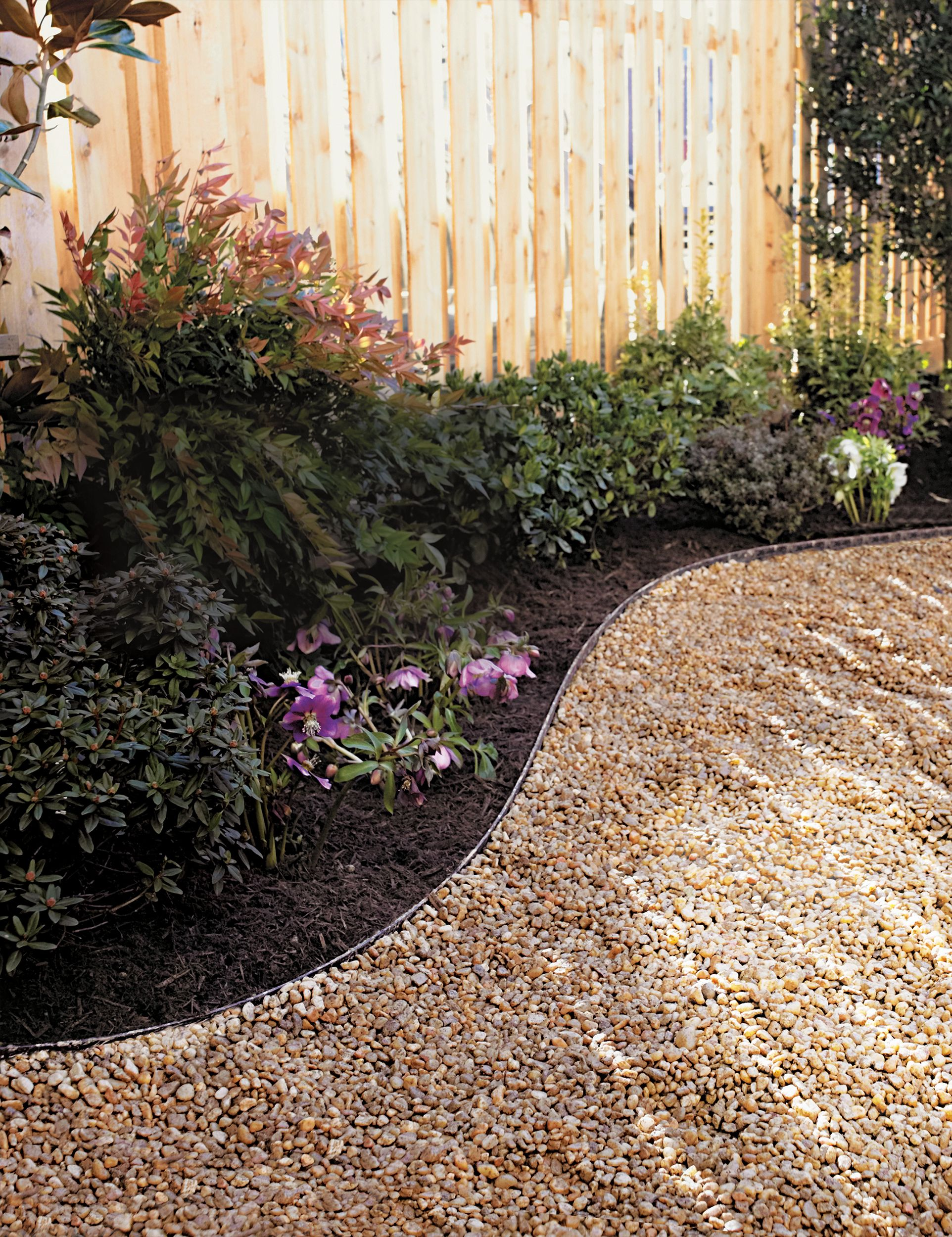 How To Lay A Budget Friendly Gravel Path Gravel Landscaping Gravel Garden Backyard Landscaping