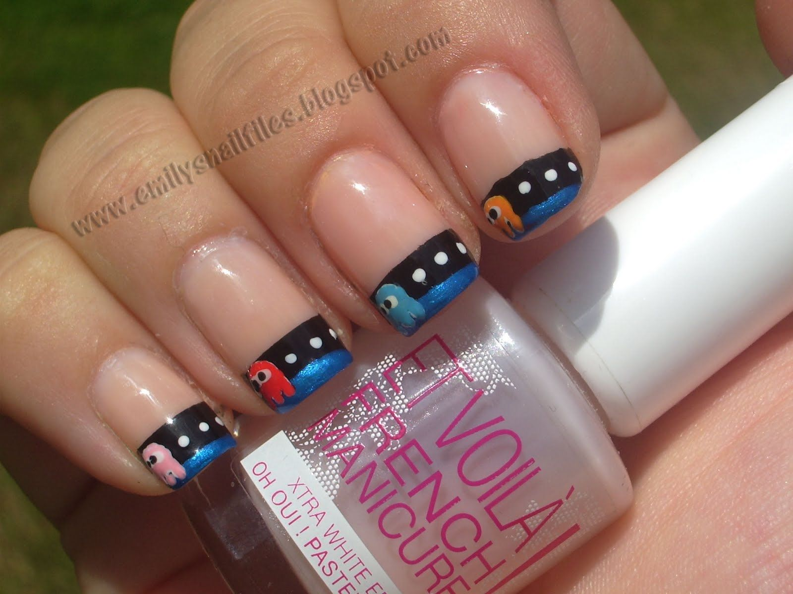PacMan French Manicure: Pac Man is always cool, French mani is less overwhelming than all over designs.