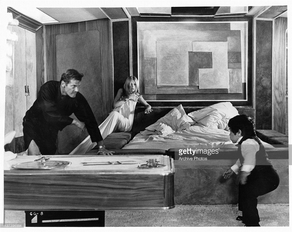 Roger Moore Chasing Herve Villechaize While Britt Ekland Huddles