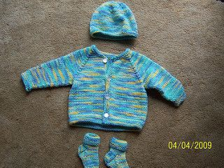 Set includes cardigan, hat and booties.