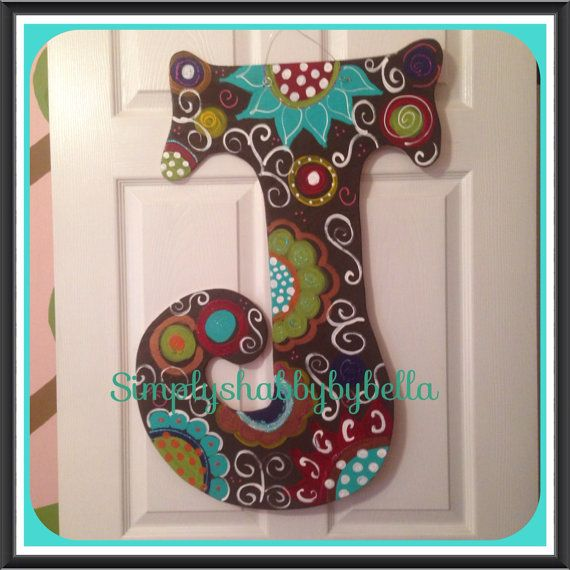 Personalized Initial Wood door hanger These letters are hand painted with acrylic paint & accented with glitter puffy paint . they are made to your order, so feel free to customized any way you want. They are sealed to withstand the weather. All letters include a Mesh or Burlap Bow with coordinating ribbons. Message me colors, designs, etc you would like. I can do any letter of the alphabet. Thank you Simplyshabbybybella -Measurements: about 24X30. The width might vary on size depending i...